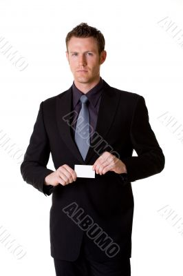 caucasian businessman in formal attire showing business card