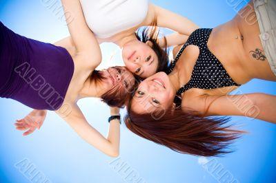 girls having fun under sunny blue sky
