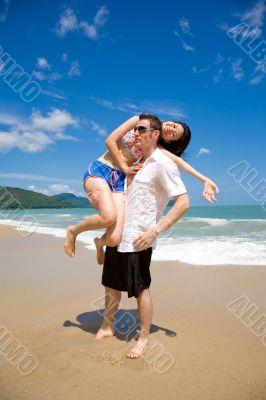 lovers having fun at the beach