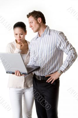 A businesswoman and businessman pay attention