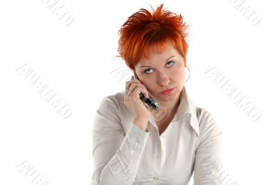 red haired woman talking by mobile phone unhappy