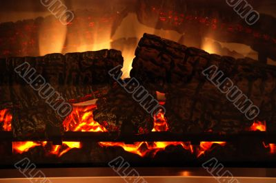 fire-place with a fire and logs