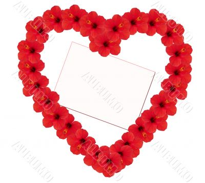 Heart from flowers with a card