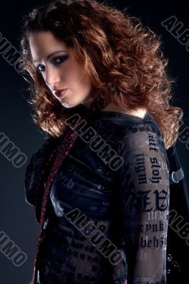 Woman with long curly hair looking confident