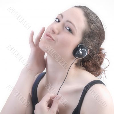 Woman with long curly hair with earphones