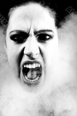 Woman with long curly hair screaming