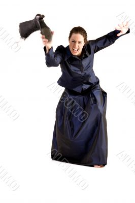 Woman with long curly hair throwing her boot