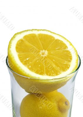 two parts of   ripe lemon in the glass