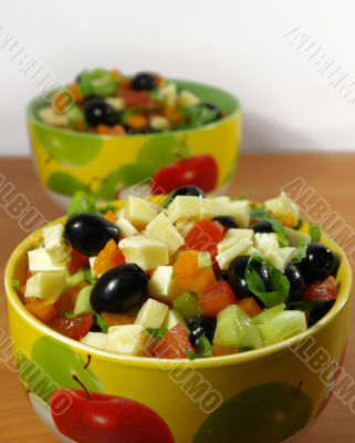 Greek salad in a bright plate