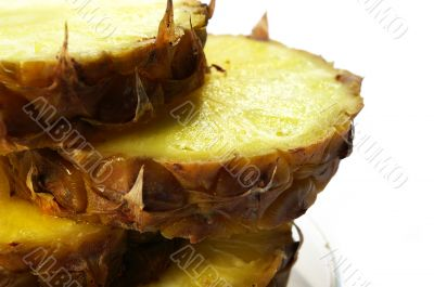 Pineapple cut on a part on a white background