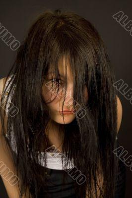 Sensual girl looking through hair