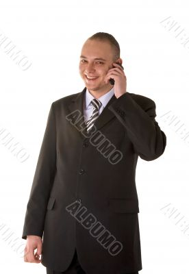 Laughing businessman calling on phone