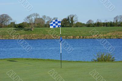 Golf flag and hole