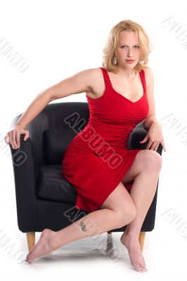 Sexy voluptuous blonde in pin-up pose