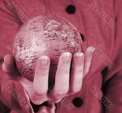 Globe in a girl`s hands