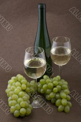 White wine with bottle, glasses and grapes