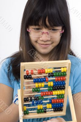 Teenager with calculator