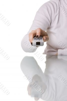 woman holding a remote control