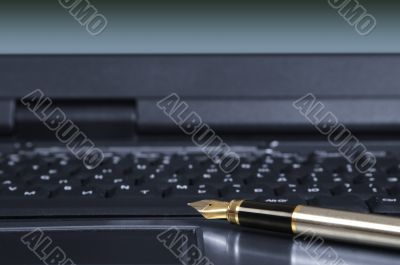 feather pen and keyboard