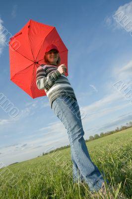 woman under red umbrella