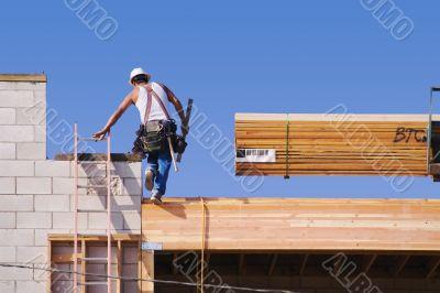 Carpenter Climbing Up Ladder
