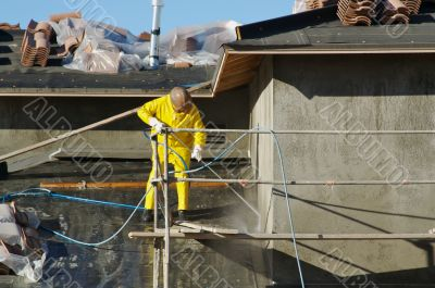 Construction Worker Pressure Washes