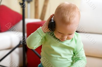 Little boy call by wireless phone at home