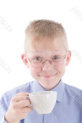 Boy enjoying a nice warm cup of coffee
