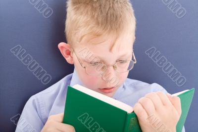 Boy reading interesting book