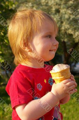 Little girl eats ice-cream
