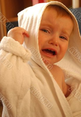 little girl cry in dressing-gown