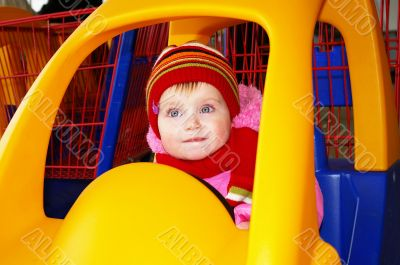 Little girl in the carriage  in a supermarket