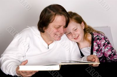 grandparent is reading to grandchild