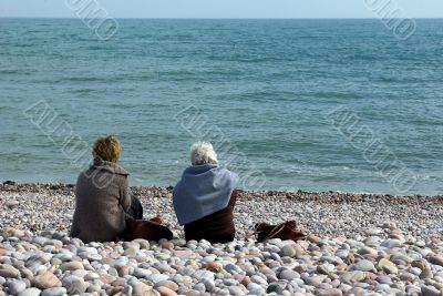 Ladies on a pebble beach 1