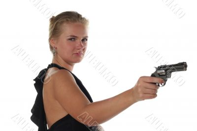 young blond woman in black dress with revolver isolated on white background