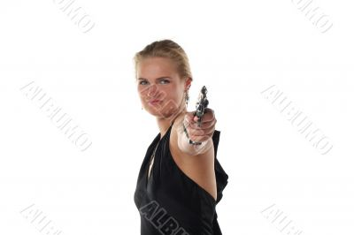 young blond woman with revolver isolated on white background