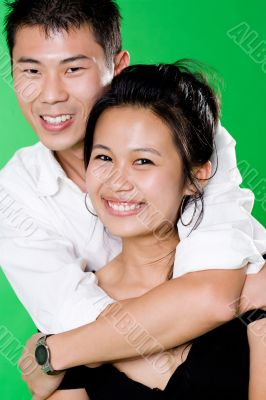 guy hugging from behind of his girl