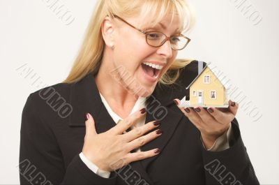 Excited Female Holding House
