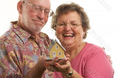 Happy Senior Couple & Home