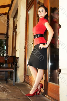 Brunette business woman in red bluse