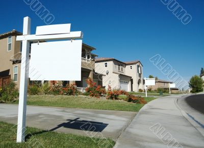 Blank Real Estate Sign & New Home