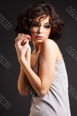 brunette girl posing on dark background