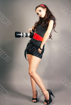 Fashion girl posing with camera