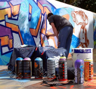 Graffiti artist at work with tools