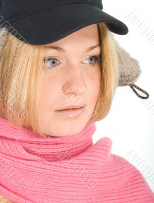 blue-eyed blonde in fur cap and  pink scarf