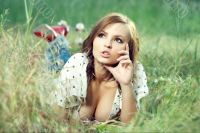 beautiful girl lying down of grass