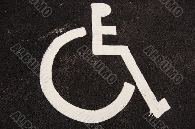 Handicap sign on asphalt