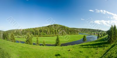 Summer landscape. Village on the river. Panorama.