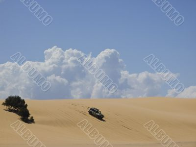 Car in the sand dune