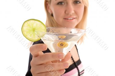 Girl reaching to you glass with martini cocktail